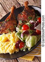 roasted duck leg with mashed potatoes and fresh salad...