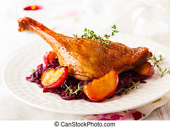 Roasted duck leg with red cabbage and apples for Christmas