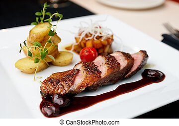 Roasted duck with pear,marinated in red wine and mascarpone...