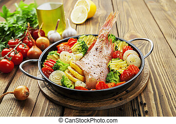 Roasted fish with vegetables - Fried fish with vegetables in...