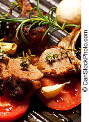 roasted lamb chop in a pan with vegetables