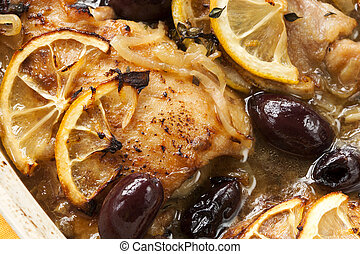 Roasted lemon chicken with black olives, onion and thyme.