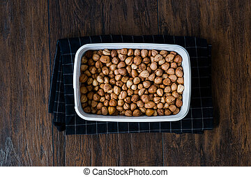 Roasted Macadamia Nuts in Plastic Box Container / Package. ...