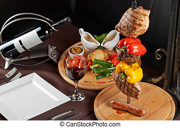 Roasted Meat - Big tasty roasted meat cuts at skewer on a...