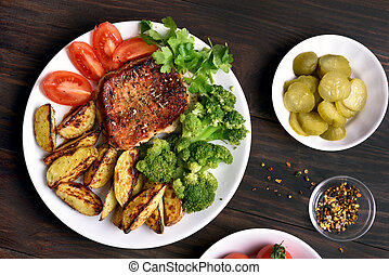 Roasted meat with vegetables, top view