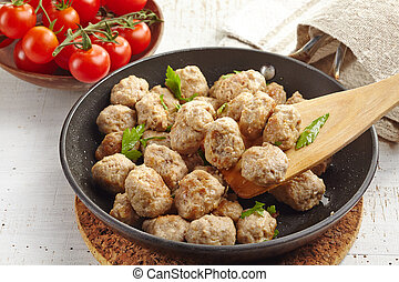 Roasted meatballs in a pan