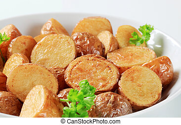 Oven-roasted new potatoes in a porcelain dish