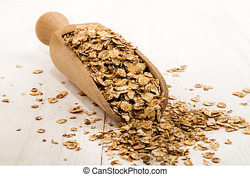 roasted oatmeal on a wooden scoop