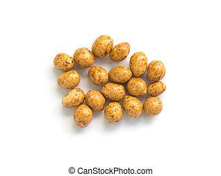 Roasted peanuts coated isolated on white background