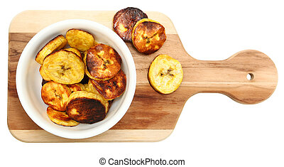 Roasted Plantains on Cutting Board Over White