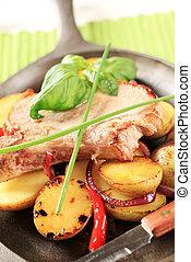 Roasted pork chop and potatoes