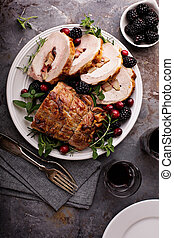 Roasted pork loin stuffed with apple and cranberry with ...
