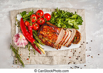 Roasted pork with thyme, rosemary, garlic and tomato sauce on white dish, white background, top view
