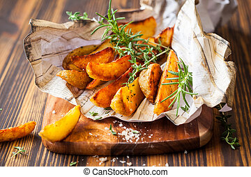 potato wedges - Roasted potato wedges with herbs and salt