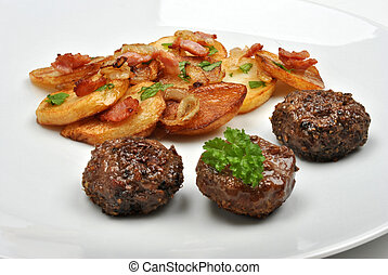 roasted potato with meat balls on a white plate