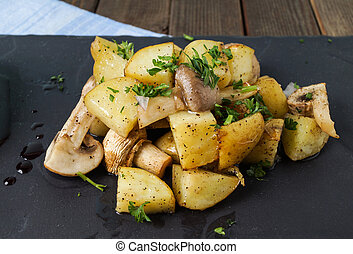 Roasted potatoes and mushrooms - Roasted sidedish with...