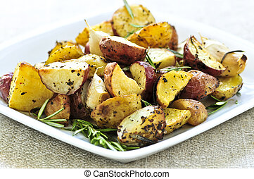 Roasted potatoes - Herb roasted potatoes served on a plate