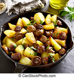 Roasted potatoes with mushrooms and sausages