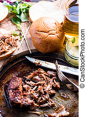 roasted pulled pork bap served with cider and apple chutney