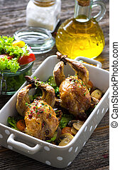 Roasted quail with vegetable on wooden background