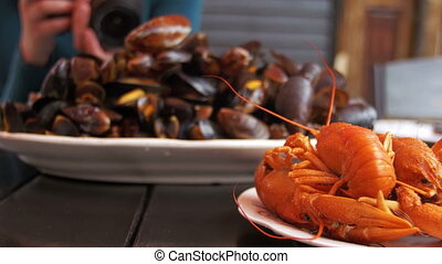 Roasted Red Crayfish and Mussels on a Wooden Table in the...