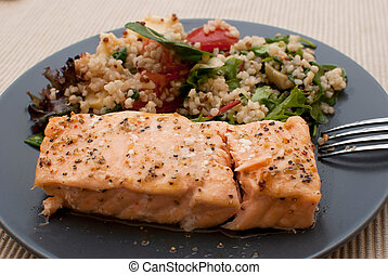 salmon - roasted salmon fillet with fresh green leaves salad...