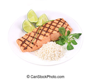 Roasted salmon fillets with rice. Isolated on a white...