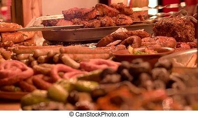 Roasted sausages and mushrooms. Tasty food macro.