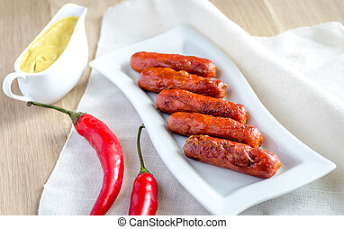 Roasted sausages with mustard sauce