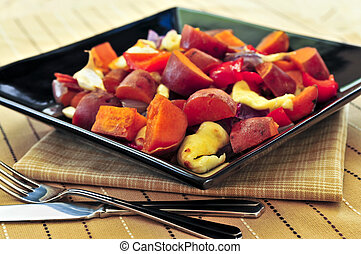 Roasted sweet potatoes - Vegetarian dish of roasted yams...