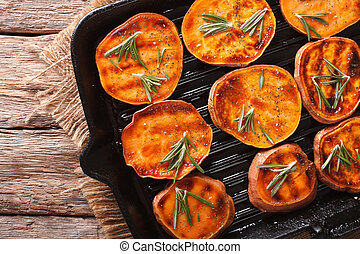 Roasted sweet potatoes with rosemary on the grill pan...