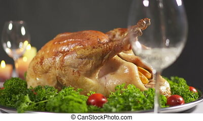Roasted Thanksgiving or Christmas turkey steaming on tray -...