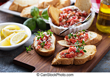 Roasted tomatoes bruschetta with thyme - Roasted tomatoes...