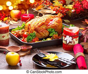 Roasted turkey garnished with potato, vegetables and...