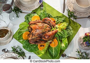 Roasted turkey with orange and served on lettuce