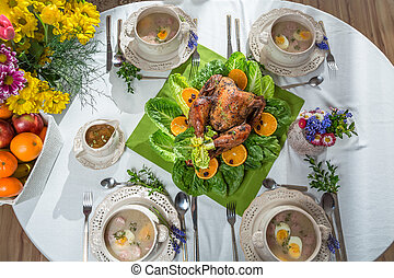 Roasted turkey with oranges served on lettuce served with soup