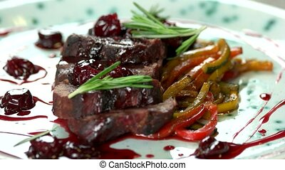 Roasted veal with cherry sauce.