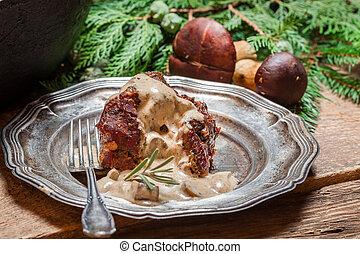Roasted venison served with mushroom sauce
