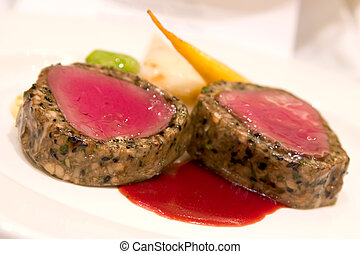 Roasted Venison with mushroom duxelles, lyonnaise potatoes and vegetables. Served with juniper berry sauce infused with port wine