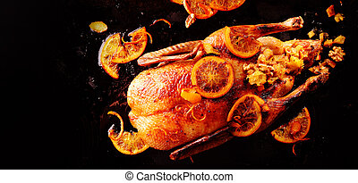 Roasted whole chicken garnished with lemon slices - One...