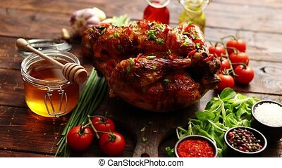 Roasted whole chicken or turkey served with chilli pepers...