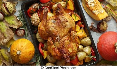 Roasted whole chicken or turkey with pumpkins, pepper and ...
