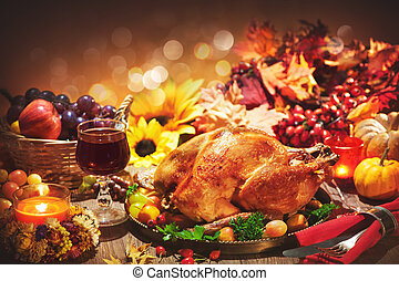Roasted whole turkey on festive table for Thanksgiving Day -...