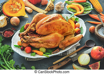 Roasted whole turkey with cooking ingredients on kitchen table