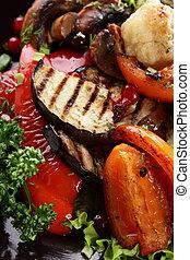 roasted vegetables with mushrooms on black hot pan