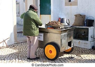 Roasting Chestnuts - CABO DA ROCA, PORTUGAL, APRIL 18, 2014:...