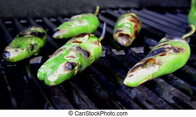 Roasting Pepper Rips Open - Green chili peppers are roasting...