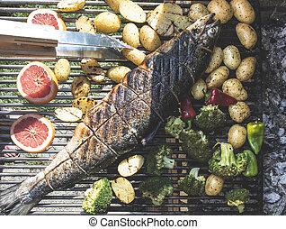 Roasting salmon fish on grill
