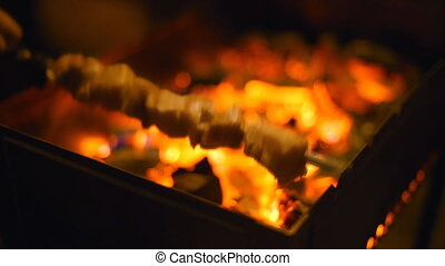 Roasting shish kebabs on the grill. Placing skewers on the...