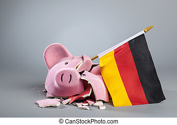 Robbed piggy bank with German flag